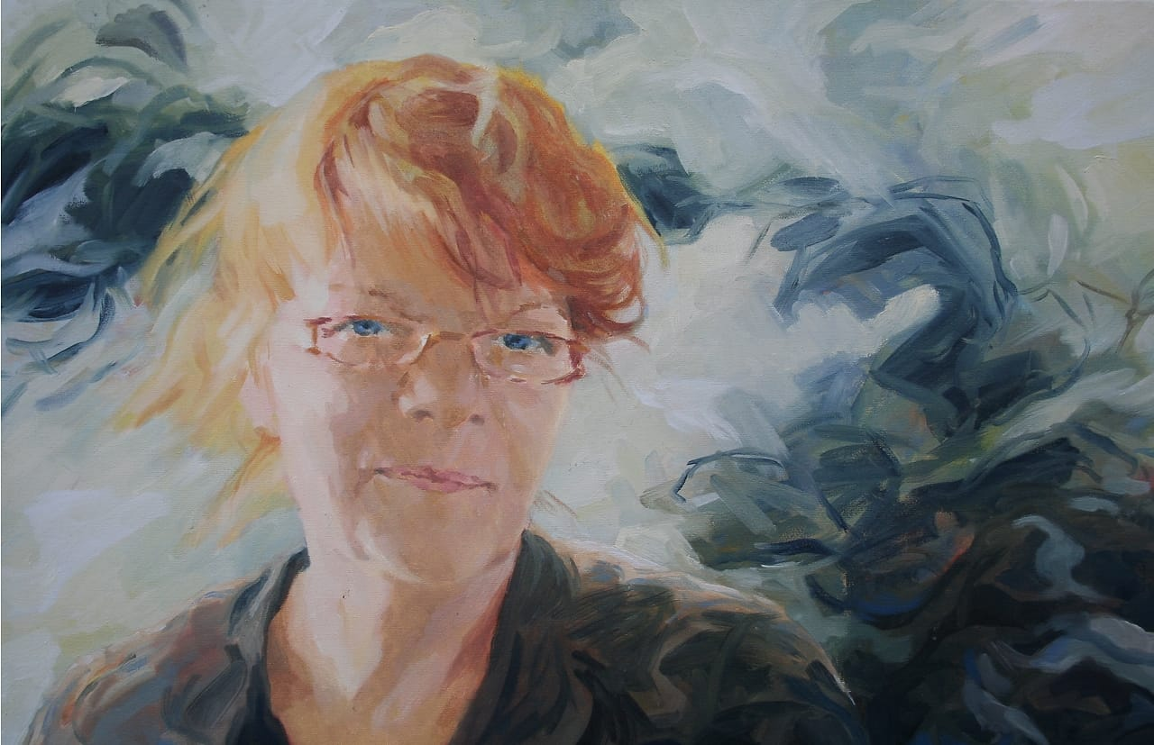 Smiling woman with glasses, posthumous portrait.